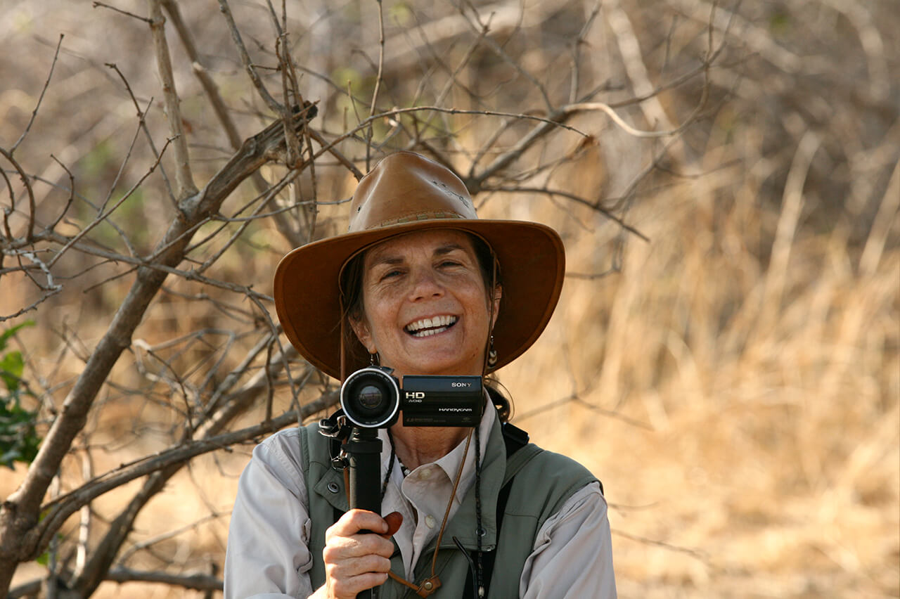 Cynthia Tuthill on safari with her video camera ready