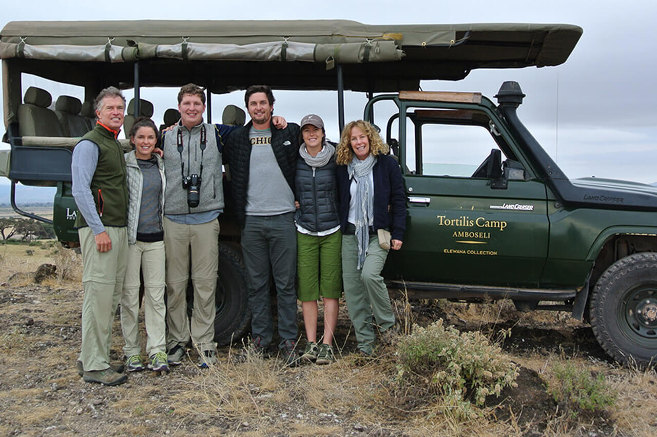 Bushtracks Expeditions travelers on a family safari stop for a photo during their game drive