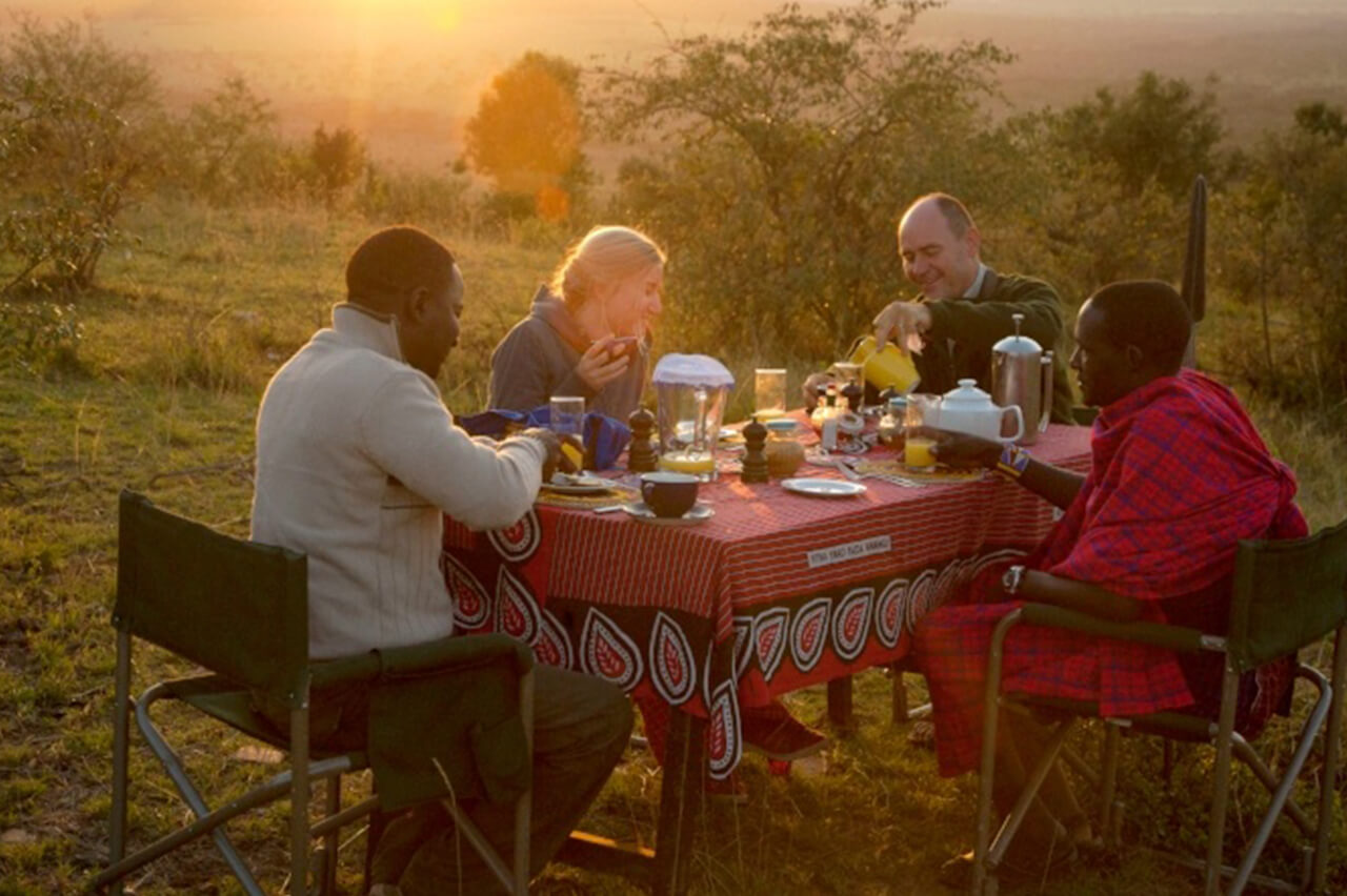 Outdoor dining provided by Nduara Loliondo Camp