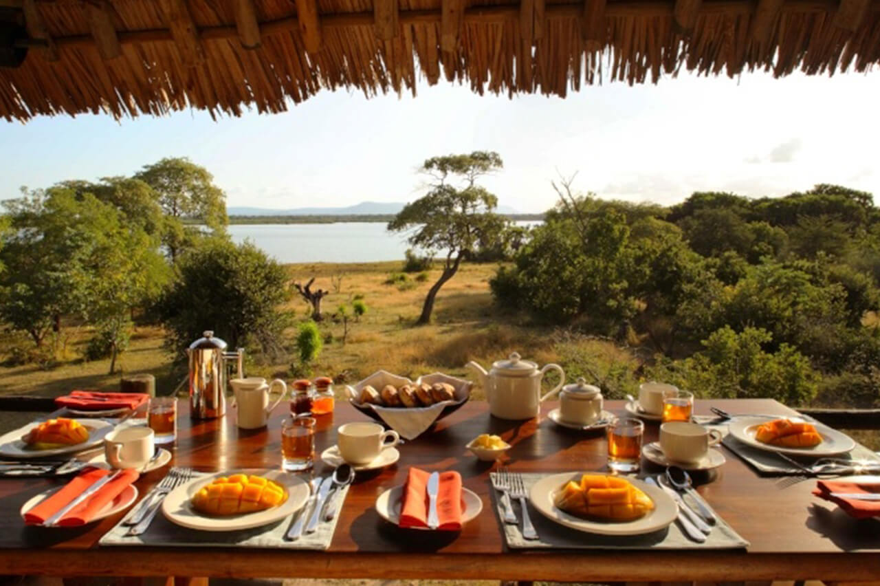 Outdoor dining provided by Siwandu Camp with a view of Selous Game Reserve in Tanzania