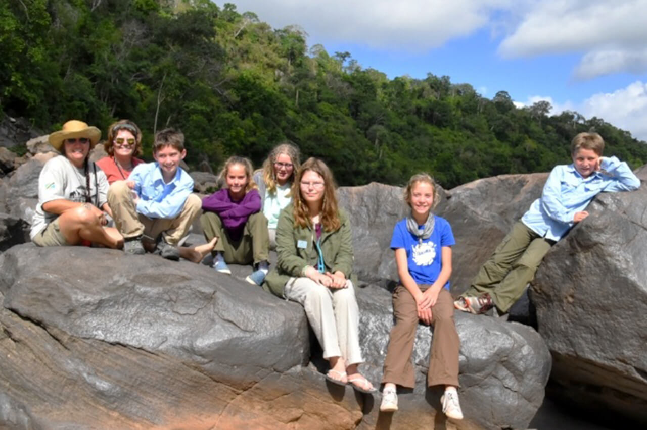 Pozos family pose on top of bolders in Africa during their Bushtracks Expeditions safari