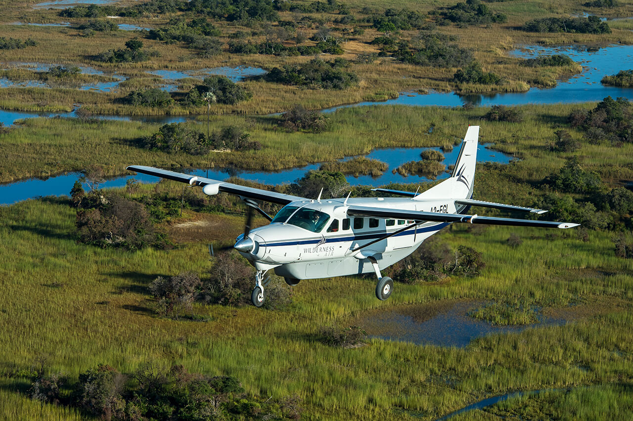 Travelers fly over Okavango Delta in Botswana with Mombo Camp - photo by Mike Myers