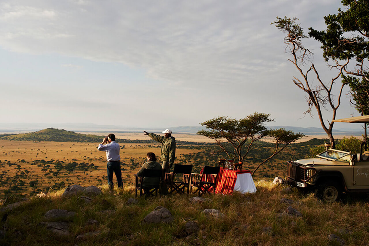 Travelers with guide during the green season in the Serengeti