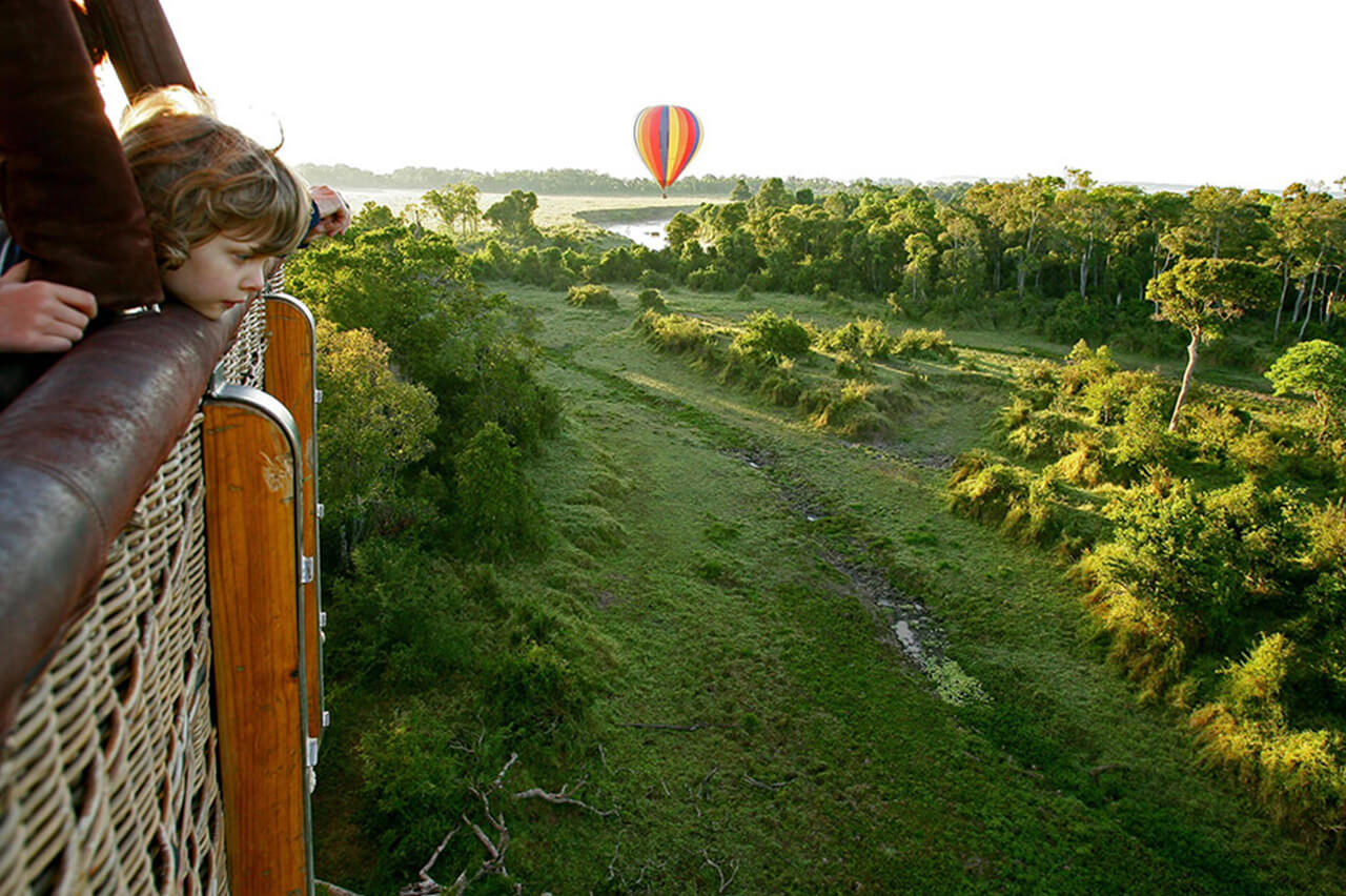 Young traveler on hot air balloon during a safari in the Serengeti
